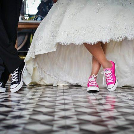 bride and groom in Converse