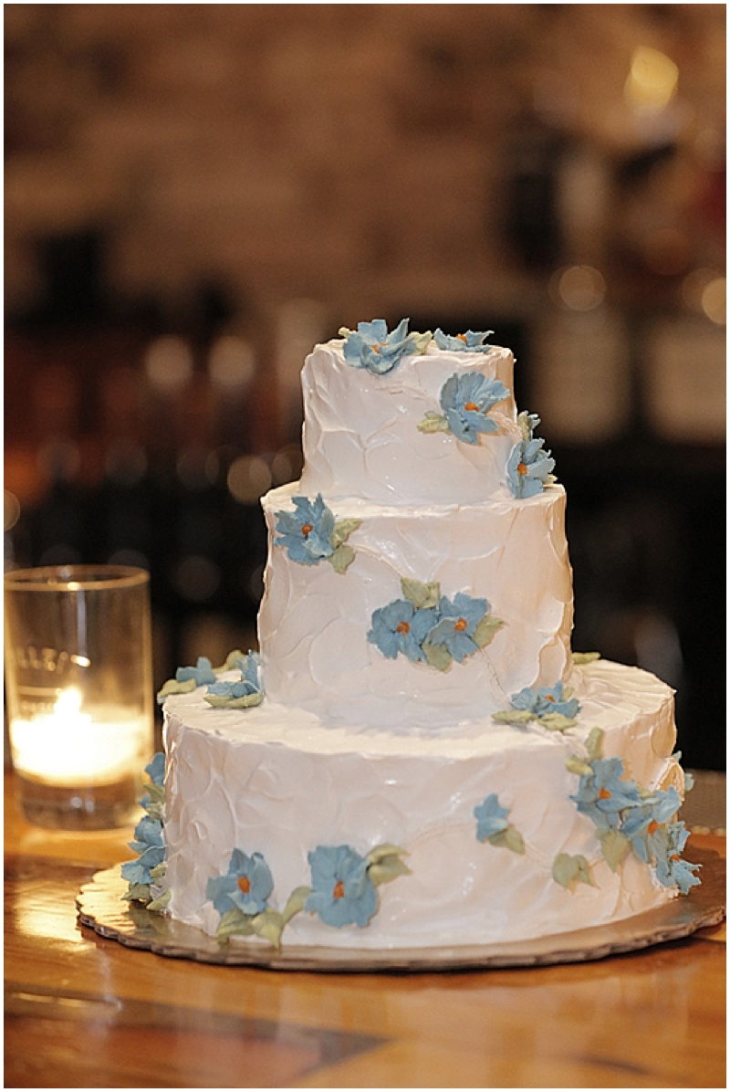 white cake with blue details