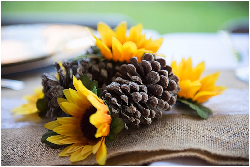 pinecone and sunflower wedding decor