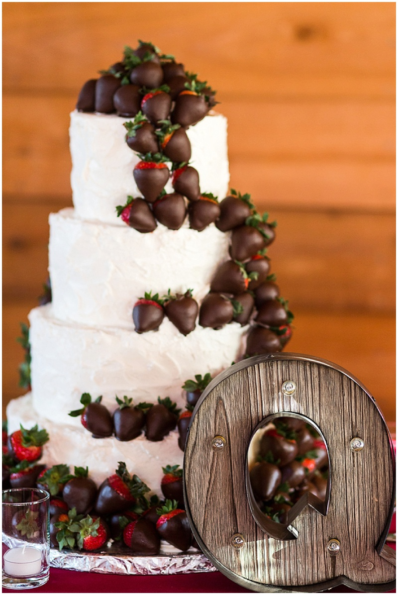 wedding cake with chocolate covered strawberries