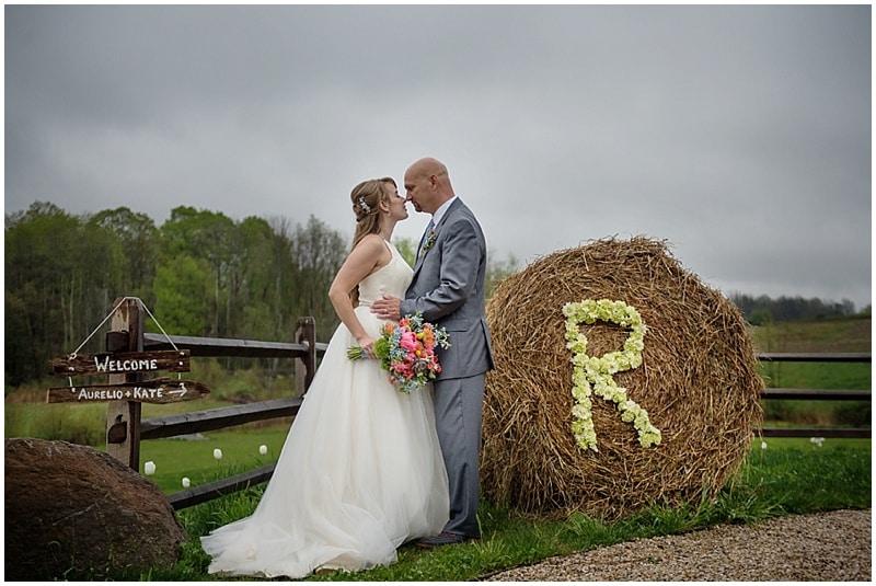couple wedding photos round hay bale