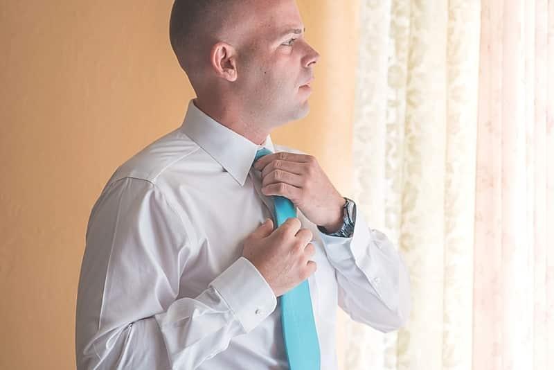 gray and blue groom attire
