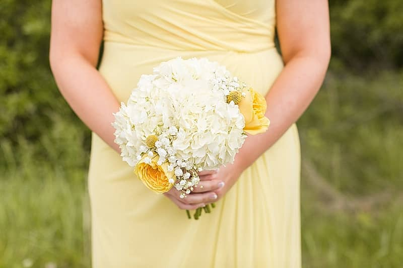 white and yellow wedding bouquet