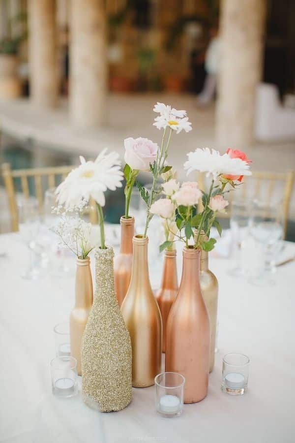 This image has an empty alt attribute; its file name is 120a5f80-upcycled-wine-bottle-wedding-decor.jpg