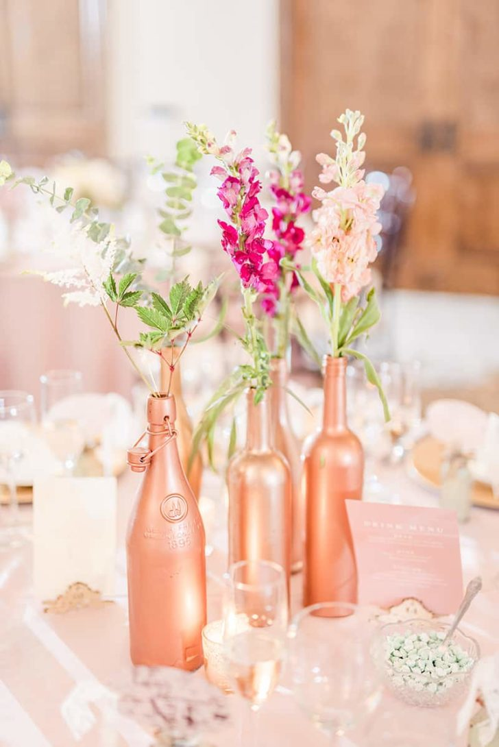 This image has an empty alt attribute; its file name is 1e8972a5-stephanie-kase-photography-painted-wine-bottle-centerpiece-728x1090.jpg