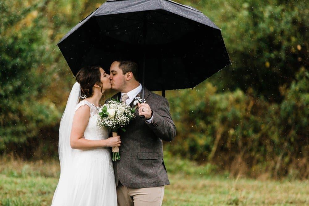 rainy day bride and groom photo