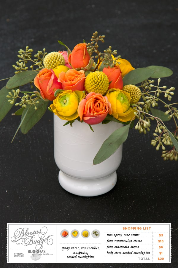 Blooms on a Budget - Summer Flower Arrangement featuring orange roses and yellow ranunculus and craspedia