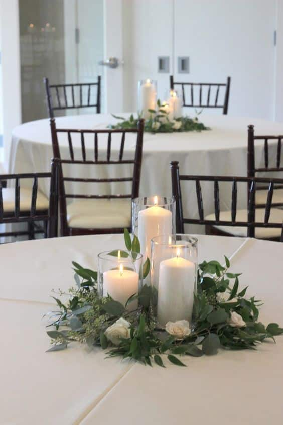 Learn how to decorate your wedding like a pro with these expert tips from Alison of Bloom Culture Flowers!  Apply the rule of 3s. Simple Candle and Greenery Centerpieces