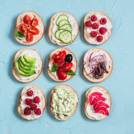 Sandwiches with cheese, tomatoes, anchovies, peppers, raspberries, avocado, bean, cucumber
