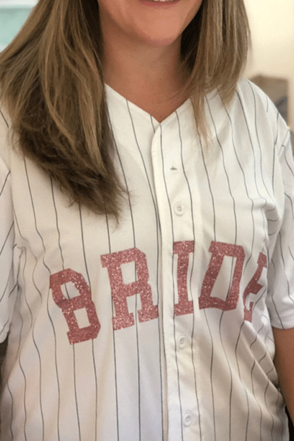 bride's personalized baseball jersey - sports themed wedding details - baseball wedding