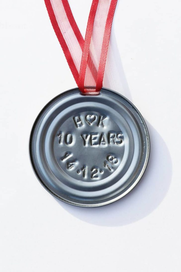 affordable tenth anniversary gift idea - personalized stamped tin christmas ornament