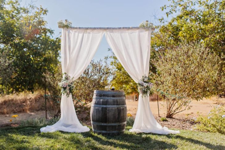 How to decorate wedding arches - fabric backdrop