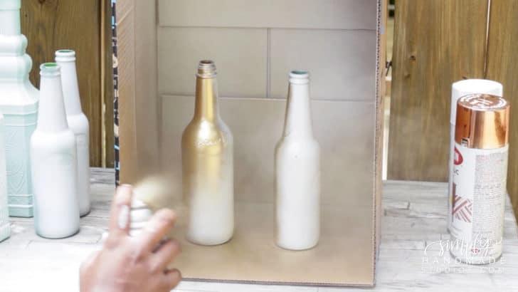spraypainting bottles for wedding decor